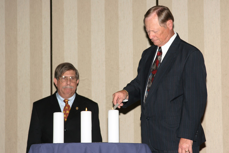 <b>IMG_43358</b><br>Chief Richard Justice, Chesapeake Police Department, lights a candle in memory of Officer Michael Saffran who received the 2006 Award for Valor posthumously