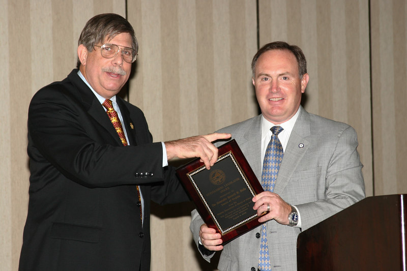<b>IMG_43387</b><br>VACP President Charles W. Bennett, Jr. presents The Honorable Kenneth Stolle with the VACP Outstanding Legislator Award in honor of the Senator's efforts to improve retirement benefits for law enforcement officers.