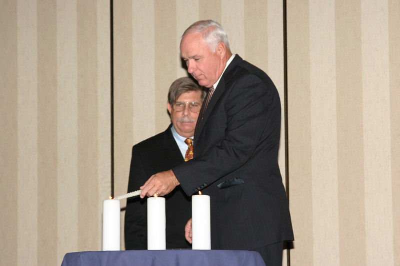 <b>IMG_43362</b><br> Colonel Carl Baker, Chesterfield County Police Department, lights a candle in memory of Officer Gary J. Buro who received the 2006 Award for Valor posthumously