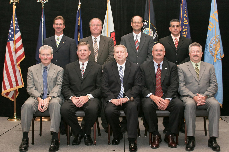 <b>2007-2008 VACP Executive Board</b><br>Front row, l. to r.: Immediate Past President, Chief J. Michael Yost, Williamsburg; First Vice President, Col. Richard J. Rappoport, City of Fairfax; President, Chief James Ray Lavinder, Roanoke County; Second Vice President, Col. M. Douglas Scott, Arlington County; Third Vice President, Chief Douglas M. Davis, Waynesboro. Back row, l. to r.: Chief Mark A. Marshall, Smithfield; Chief Richard C. Clark, Jr., Galax; Chief James E. Williams, Staunton; Chief Timothy J. Longo, Sr., Charlottesville. (Not pictured: Chief Bruce Preston Marquis, Norfolk)