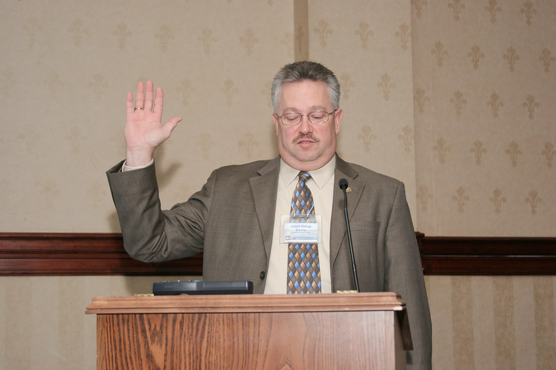 <b>IMG_54997</b><br>VACP Board Member Chief Doug Davis (Waynesboro) leads the membership in the Oath of Honor to open the conference.