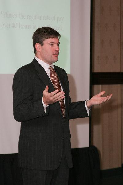 <b>IMG_55024</b><br>Thomas Winn tries to clarify key issues of the Fair Labor Standards Act.
