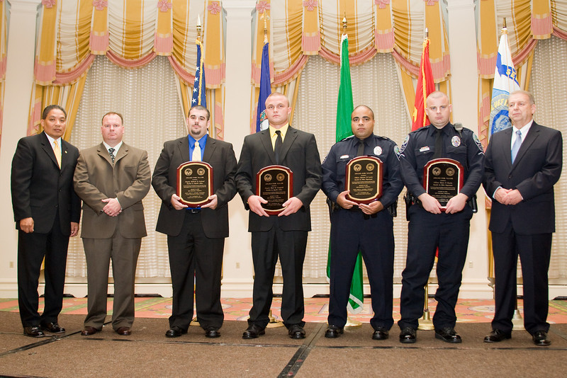 <u>2008 VACP/VPCF Valor Award Recipients:</u> (l. to r.) Deputy Richard B. Garland & Deputy Brad M. Campbell, Franklin County Sheriff's Office; and, Officer Spencer D. Lewis & Officer Shaun P. Chuyka, Roanoke Co. Police Department. (others, l. to r.: The Honorable John Marshall, Secretary of Public Safety; Major Josh Carter, Franklin Co. Sheriff's Office; and Roanoke Co. Police Chief Ray Lavinder, 2007-2008 VACP President.)