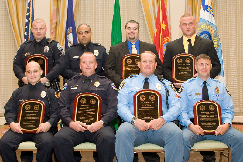 """<u>2008 VACP/VPCF Valor Award Recipients</u>: (front, l. to r.) Officer Joshua Wright, Bluefield PD; Lt. Kevin J. Testerman, Chilhowie PD; Police Officer Specialist Raymond Kerr, Chesapeake PD; Police Officer Specialist Norwood """"Trea"""" King, Chesapeake PD; (back, l. to r.) Officer Shaun P. Chukya, Roanoke Co. PD; Officer Spencer D. Lewis, Roanoke Co. PD; Deputy Richard B. Garland, Franklin County Sheriff's Office; and Deputy Brad M. Campbell, Franklin Co. Sheriff's Office."""