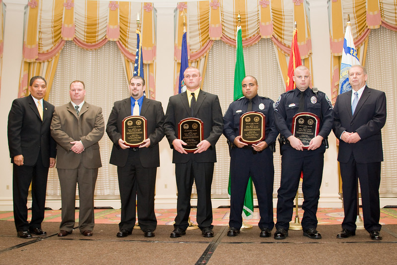 <u>2008 VACP/VPCF Valor Award Recipients:</u> (l. to r.) Deputy Richard B. Garland & Deputy Brad M. Campbell, Franklin County Sheriff's Office; and, Officer Spencer D. Lewis & Officer Shaun P. Chuyka, Roanoke Co. Police Department. (others, l. to r.: The Honorable John Marshall, Secretary of Public Safety; , Franklin Co. Sheriff's Office; and Roanoke Co. Police Chief Ray Lavinder, 2007-2008 VACP President.)