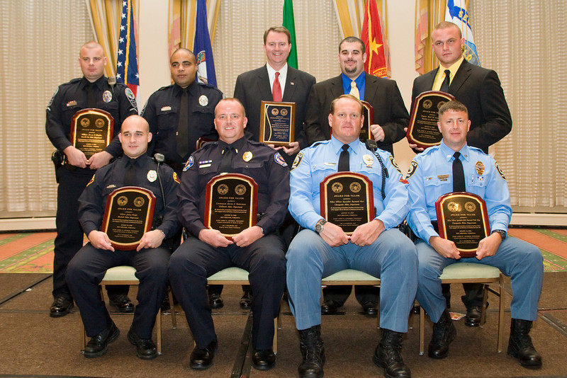 """<u>2008 Award Recipients</u>: (front, l. to r.) Officer Joshua Wright, Bluefield PD; Lt. Kevin J. Testerman, Chilhowie PD; Police Officer Specialist Raymond Kerr, Chesapeake PD; Police Officer Specialist Norwood """"Trea"""" King, Chesapeake PD; (back, l. to r.) Officer Shaun P. Chukya, Roanoke Co. PD; Officer Spencer D. Lewis, Roanoke Co. PD; The Honorable John L. Brownlee; Deputy Richard B. Garland, Franklin County Sheriff's Office; and Deputy Brad M. Campbell, Franklin Co. Sheriff's Office."""