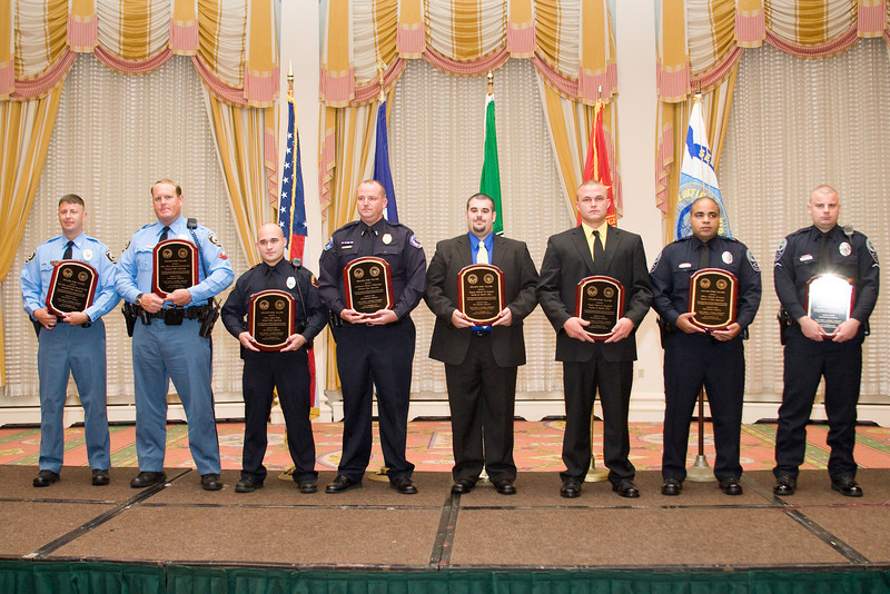 """<u>2008 VACP/VPCF Valor Award Recipients</u>: (l. to r.) Police Officer Specialist Norwood """"Trea"""" King, Chesapeake PD; Police Officer Specialist Raymond Kerr, Chesapeake PD; Officer Joshua Wright, Bluefield PD; Lt. Kevin J. Testerman, Chilhowie PD; Deputy Richard B. Garland, Franklin County Sheriff's Office; Deputy Brad M. Campbell, Franklin Co. Sheriff's Office; Officer Spencer D. Lewis, Roanoke Co. PD; and Officer Shaun P. Chukya, Roanoke Co. PD."""