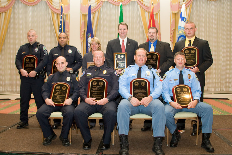 """<u>2008 Award Recipients</u>: (front, l. to r.) Officer Joshua Wright, Bluefield PD; Lt. Kevin J. Testerman, Chilhowie PD; Police Officer Specialist Raymond Kerr, Chesapeake PD; Police Officer Specialist Norwood """"Trea"""" King, Chesapeake PD; (back, l. to r.) Officer Shaun P. Chukya, Roanoke Co. PD; Officer Spencer D. Lewis, Roanoke Co. PD; Chief Kim Crannis, Blacksburg PD; The Honorable John L. Brownlee; Deputy Richard B. Garland, Franklin County Sheriff's Office; and Deputy Brad M. Campbell, Franklin Co. Sheriff's Office."""