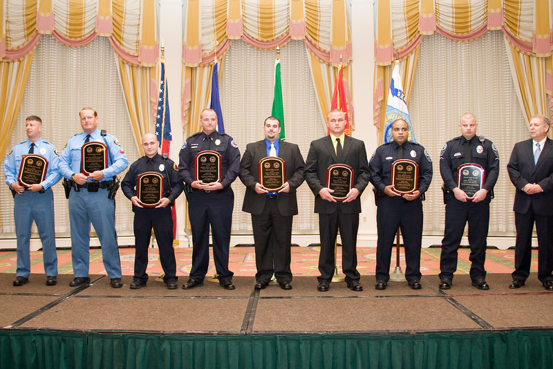 """<u>2008 VACP/VPCF Valor Award Recipients</u>: (l. to r.) Police Officer Specialist Norwood """"Trea"""" King, Chesapeake PD; Police Officer Specialist Raymond Kerr, Chesapeake PD; Officer Joshua Wright, Bluefield PD; Lt. Kevin J. Testerman, Chilhowie PD; Deputy Richard B. Garland, Franklin County Sheriff's Office; Deputy Brad M. Campbell, Franklin Co. Sheriff's Office; Officer Spencer D. Lewis, Roanoke Co. PD; and Officer Shaun P. Chukya, Roanoke Co. PD; with 2007-2008 VACP President Chief Ray Lavinder, Roanoke Co. PD."""
