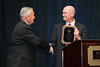 Chief Charlie T. Deane, Prince William County Police is presented with the 2010 VACP President's Award from 2009-10 VACP President Chief Doug Scott, Arlington County Police