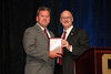 John Monroe, Verizon Wireless received Platinum Sponsor Recognition Plaque from VACP President Doug Scott