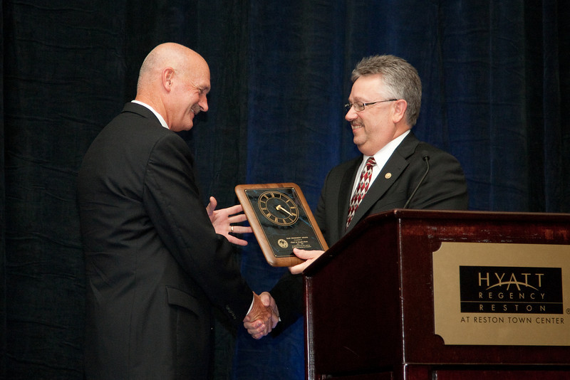 2010-11 VACP President Chief Douglas L. Davis, Waynesboro Police presents the Past President's Award to 2009-10 VACP President Chief Doug Scott, Arlington County Police