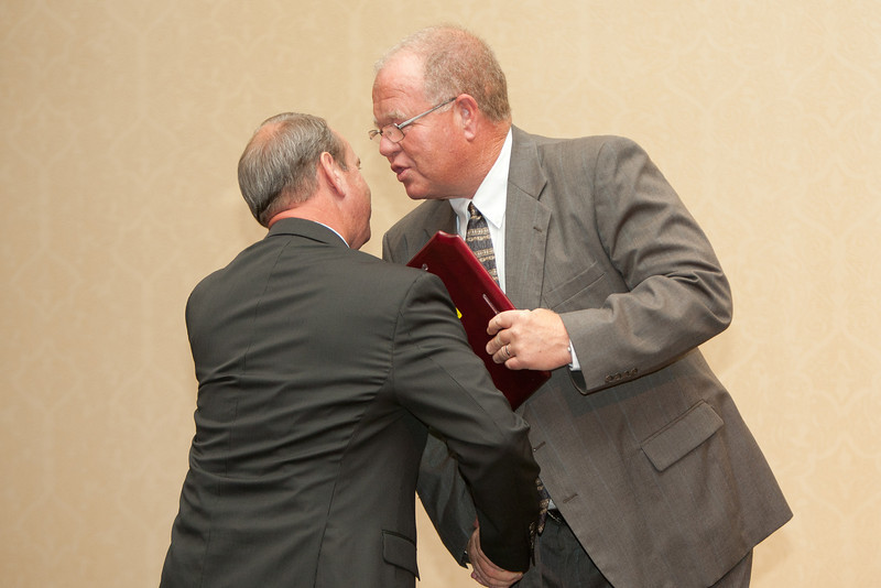 Chief Clark presents Virginia Tech Police Chief Wendell Flinchum with the VACP President's Award.