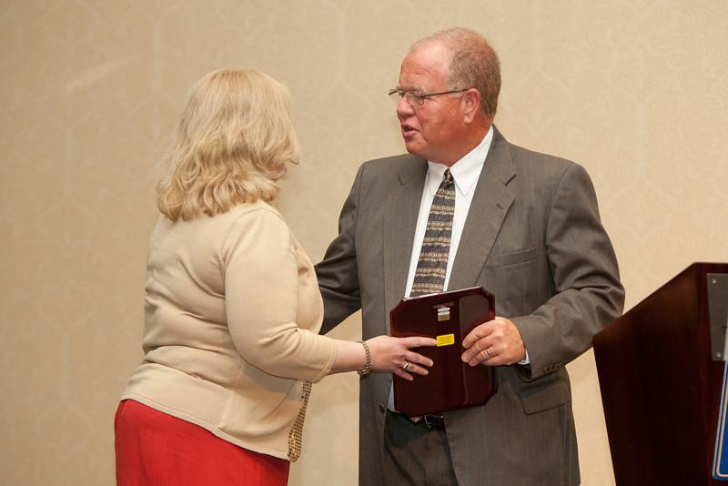 Chief Clark presents VACP Executive Director Dana Schrad with the VACP President's Award.