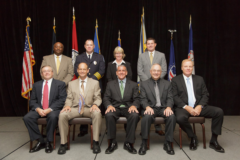 2013-14 VACP Executive Board: (front, L to R) Third VP, Colonel Thierry Dupuis, Chesterfield County; Immediate Past President, Chief Jim Williams, Staunton; President, Chief Tim Longo, Charlottesville; First Vice President, Chief Gary Roche, Pulaski; Second Vice President, Chief Dave Sloggie. (back, L to R) Executive Board Members Chief Kelvin Wright, Chesapeake; Chief Doug Goodman, Ashland; Chief Kimberley Crannis, Blacksburg; and Chief Chris Perkins, Roanoke.  (Not Pictured: Col. Steve Sellers, Albemarle County)