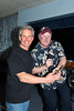 Ben Cockman receiving 1st place chili trophy from auctioneer Craig Bennett @ VAP fundraiser 10-15-2011