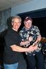 Ben Cockman receiving 1st place chili trophy from auctioneer Craig Bennett @ VAP fundraiser 10-15-2011