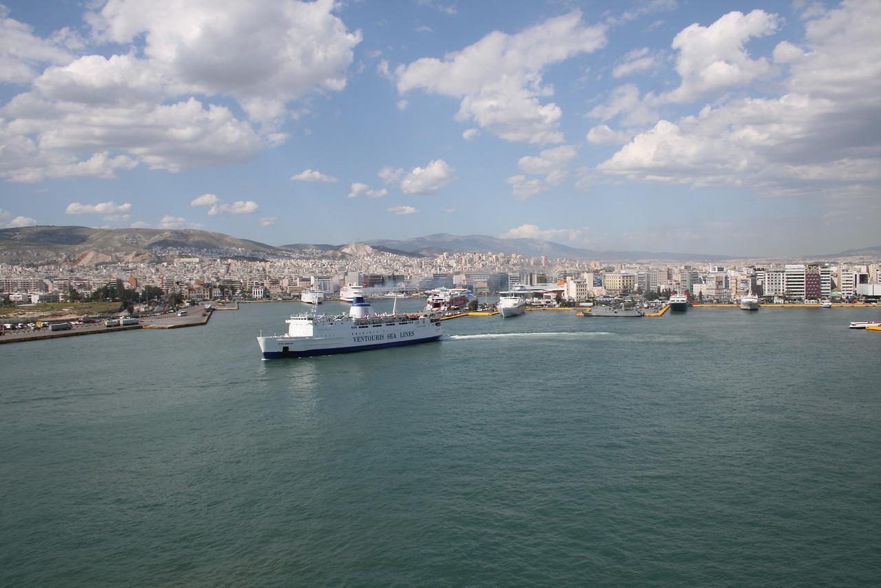 2008 - F/B AGIOS GEORGIOS leaving Piraeus to Kythnos - Serifos - Sifnos - Kimolos - Milos. A view to Piraeus wide port area and town.