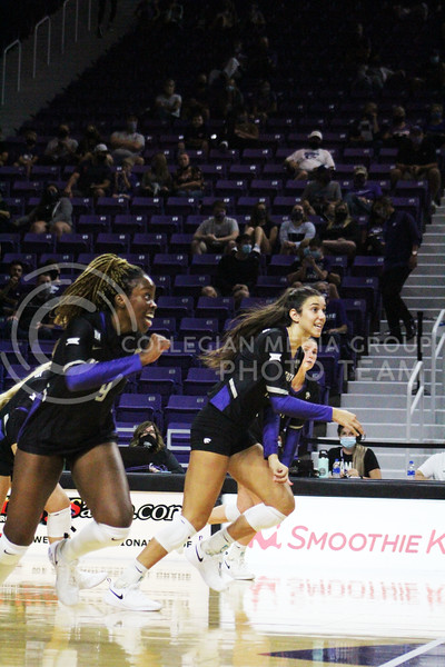 After a play, Abigail Archibong and Holly Bonde rush over to teammate to celebrate  during the K-State volleyball game against Iowa State at Bramlage Coliseum on Sept. 25, 2020. (Jordan Henington | Collegian Media Group)