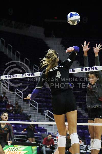 In the air, Kadye Fernholz gets ready to spike the ball  during the K-State volleyball game against Iowa State at Bramlage Coliseum on Sept. 25, 2020. (Jordan Henington | Collegian Media Group)