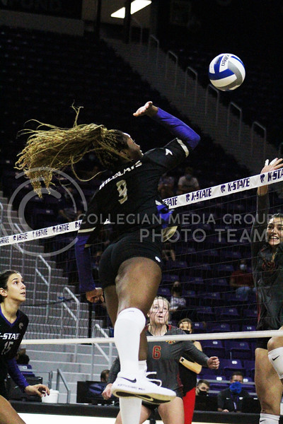 In the air, Abigail Archibong spikes the ball over the net  during the K-State volleyball game against Iowa State at Bramlage Coliseum on Sept. 25, 2020. (Jordan Henington | Collegian Media Group)