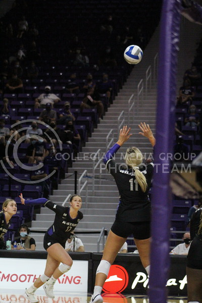 Number 11 gets ready to set the ball to her teammate number 17 during the K-State volleyball game against Iowa State at Bramlage Colesieum on Sept. 25, 2020.