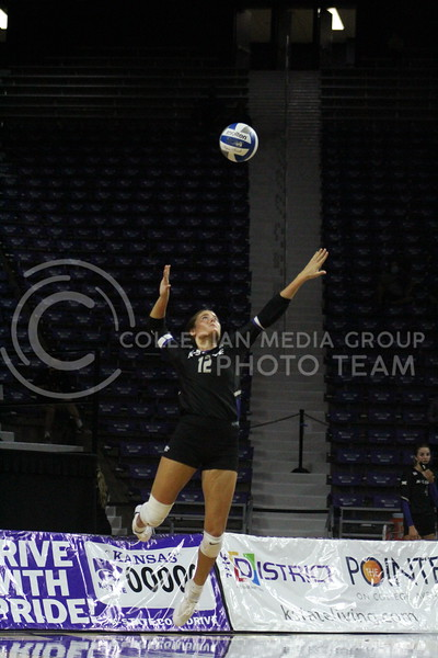 In position, number 12 jumps into the air to get ready to spike the ball during the K-State volleyball game against Iowa State at Bramlage Coliseum on Sept. 25, 2020.