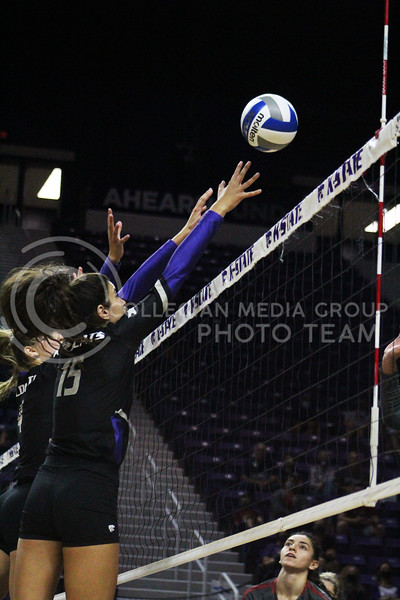 Prepared for block, Holly Bonde jumps in the air  during the K-State volleyball game against Iowa State at Bramlage Coliseum on Sept. 25, 2020. (Jordan Henington | Collegian Media Group)