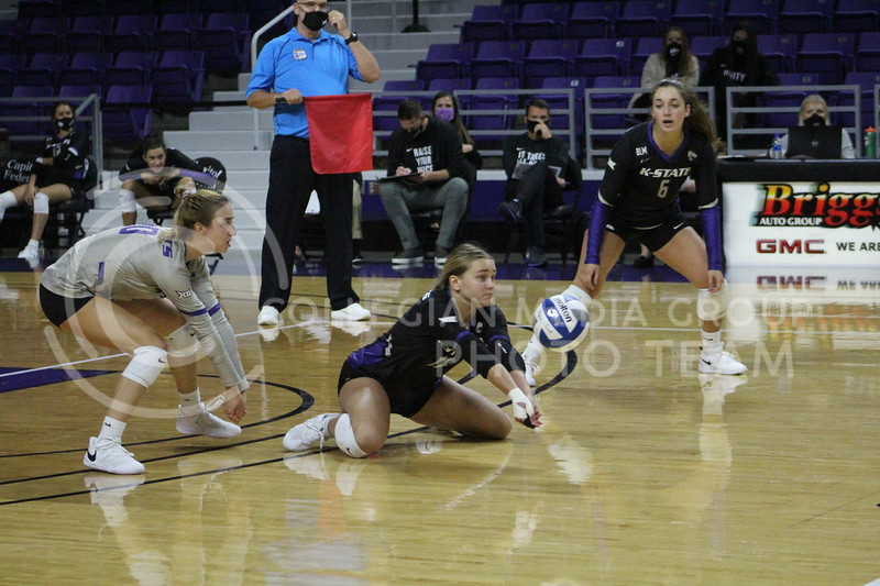 Down on the ground, number 16 hits the ball before it bounces on the ground during the K-State volleyball game against Iowa State at Bramlage Coliseum on Sept. 25, 2020.