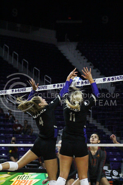 Working together, Kadye Fernholz and Shelby Martin block the ball  during the K-State volleyball game against Iowa State at Bramlage Coliseum on Sept. 25, 2020. (Jordan Henington | Collegian Media Group)