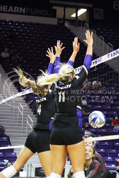 Jumping, players Kadye Fernholz and Shelby Martin block the ball  during the K-State volleyball game against Iowa State at Bramlage Coliseum on Sept. 25, 2020. (Jordan Henington | Collegian Media Group)