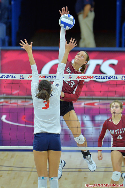 September 18, 2015: Gwen Murphy skies above the Arizona block in a match between New Mexico State and No. 16 Arizona at McKale Memorial Center in Tucson, Ariz.