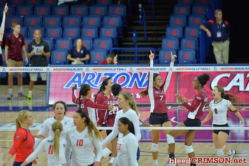 September 18, 2015: The Aggies celebrate winning set point in a match between New Mexico State and No. 16 Arizona at McKale Memorial Center in Tucson, Ariz.
