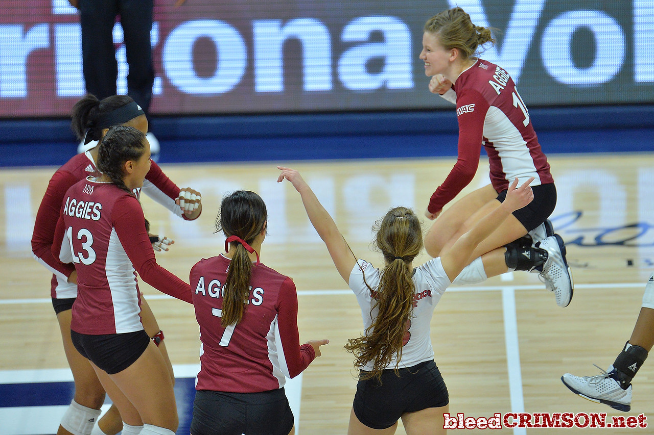 September 18, 2015: The Aggies celebrate a point in a match between New Mexico State and No. 16 Arizona at McKale Memorial Center in Tucson, Ariz.