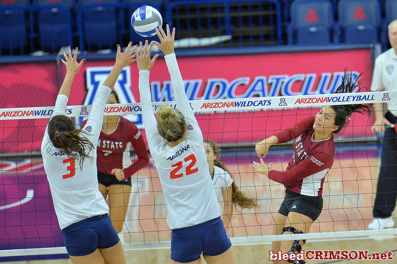 September 18, 2015: Bradley Nash sends a ball past the Arizona block in a match between New Mexico State and No. 16 Arizona at McKale Memorial Center in Tucson, Ariz.