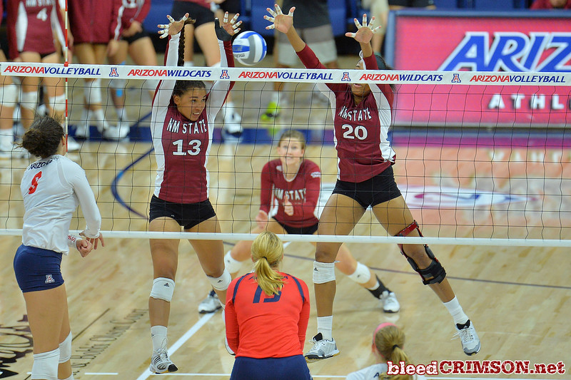 September 18, 2015: Nathalie Castellanos and Sasha-Lee Thomas team up for a block in a match between New Mexico State and No. 16 Arizona at McKale Memorial Center in Tucson, Ariz.