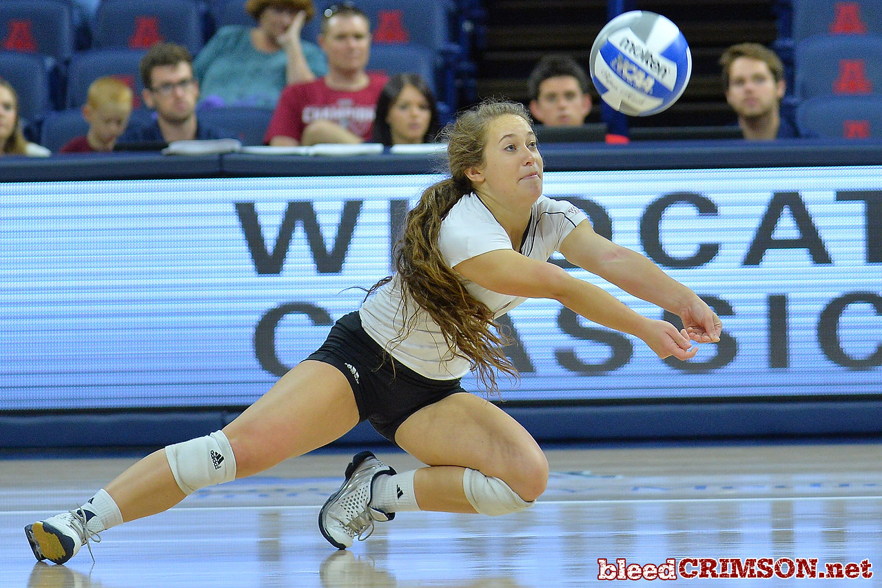 September 18, 2015: Kaylee Neal dives for a dig in a match between New Mexico State and No. 16 Arizona at McKale Memorial Center in Tucson, Ariz.