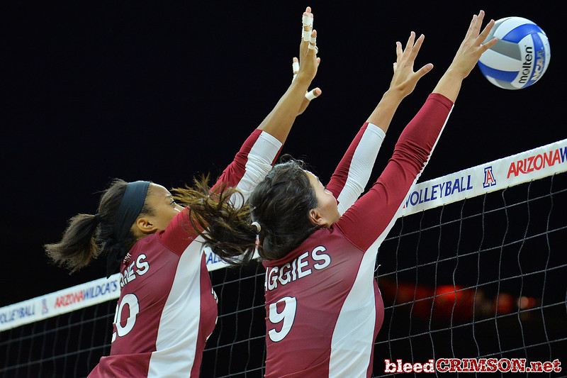 September 18, 2015: Sasha-Lee Thomas and Bradley Nash go up for a block in a match between New Mexico State and No. 16 Arizona at McKale Memorial Center in Tucson, Ariz.