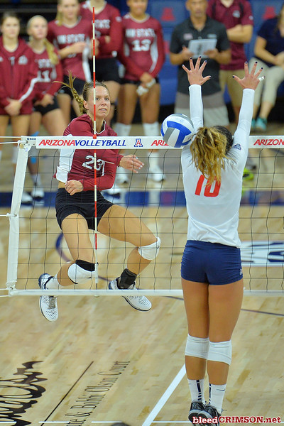 September 18, 2015: Gwen Murphy sends a ball past an Arizona blocker in a match between New Mexico State and No. 16 Arizona at McKale Memorial Center in Tucson, Ariz.
