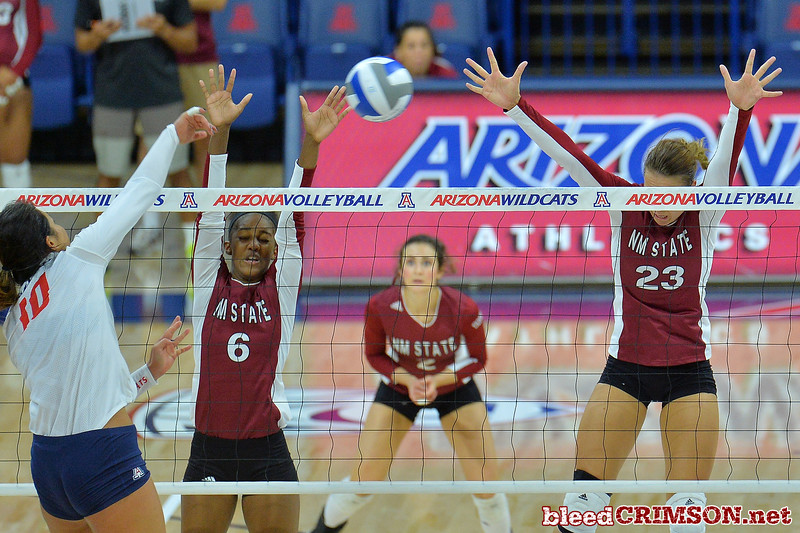 September 18, 2015: Tatyana Battle and Gwen Murphy go up for a block in a match between New Mexico State and No. 16 Arizona at McKale Memorial Center in Tucson, Ariz.