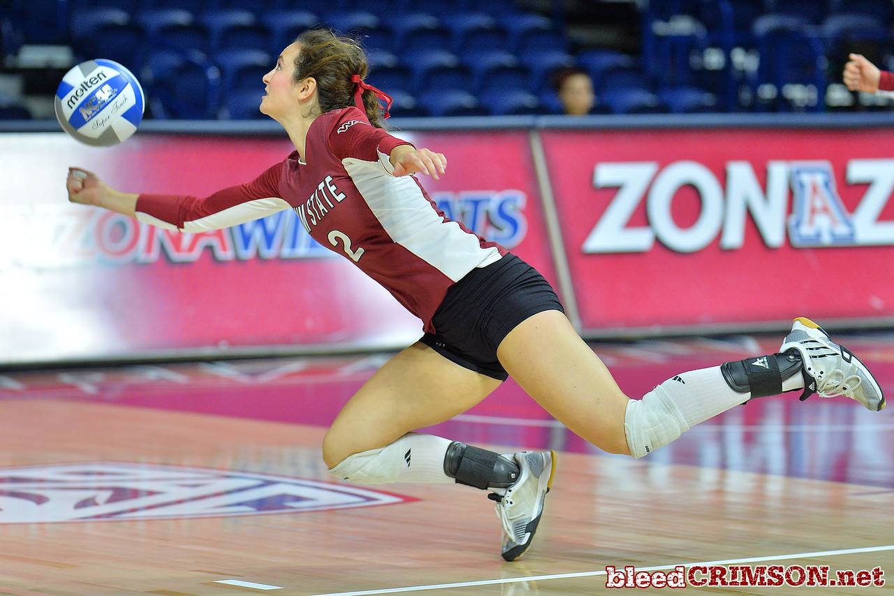 September 18, 2015: Taylor Livoti dives for a dig in a match between New Mexico State and No. 16 Arizona at McKale Memorial Center in Tucson, Ariz.