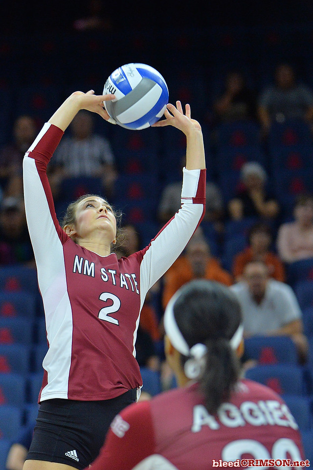 September 19, 2015: Taylor Livoti sets a ball in a match between New Mexico State and No. 2 Texas at McKale Memorial Center in Tucson, Ariz.