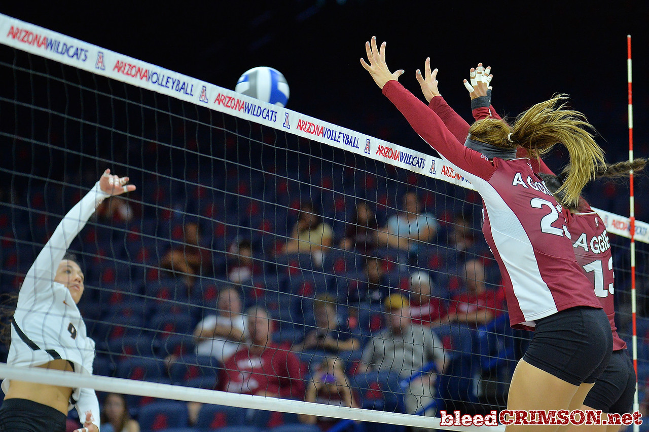 September 19, 2015: Gwen Murphy and Nathalie Castellanos go up for a block against Texas outside hitter Amy Neal (9) in a match between New Mexico State and No. 2 Texas at McKale Memorial Center in Tucson, Ariz.