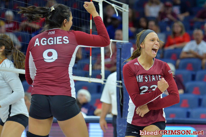 September 19, 2015: Gwen Murphy and Bradley Nash celebrate a point in a match between New Mexico State and No. 2 Texas at McKale Memorial Center in Tucson, Ariz.