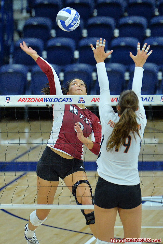 September 19, 2015: Bradley Nash takes a swing over the block of Texas outside hitter Paulina Prieto Cerame (19) in a match between New Mexico State and No. 2 Texas at McKale Memorial Center in Tucson, Ariz.