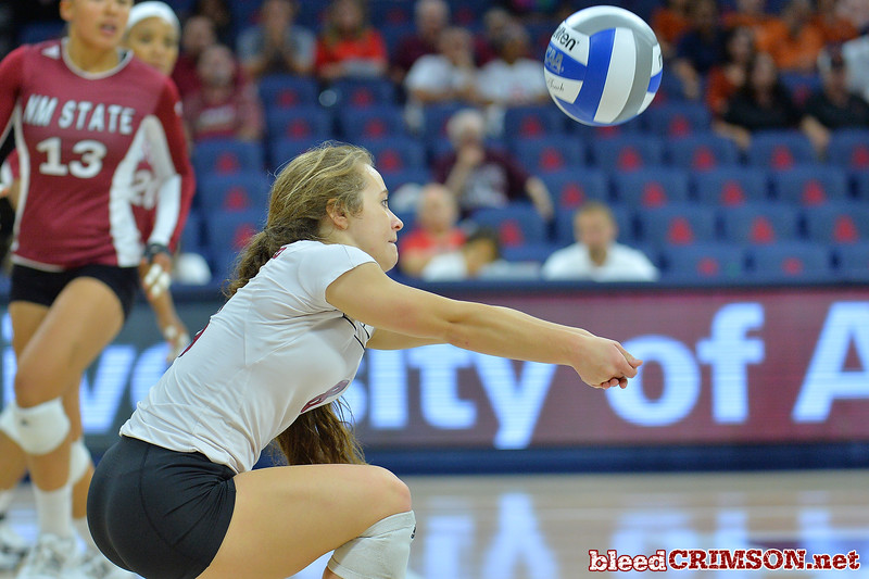 September 19, 2015: Kaylee Neal digs a ball in a match between New Mexico State and No. 2 Texas at McKale Memorial Center in Tucson, Ariz.