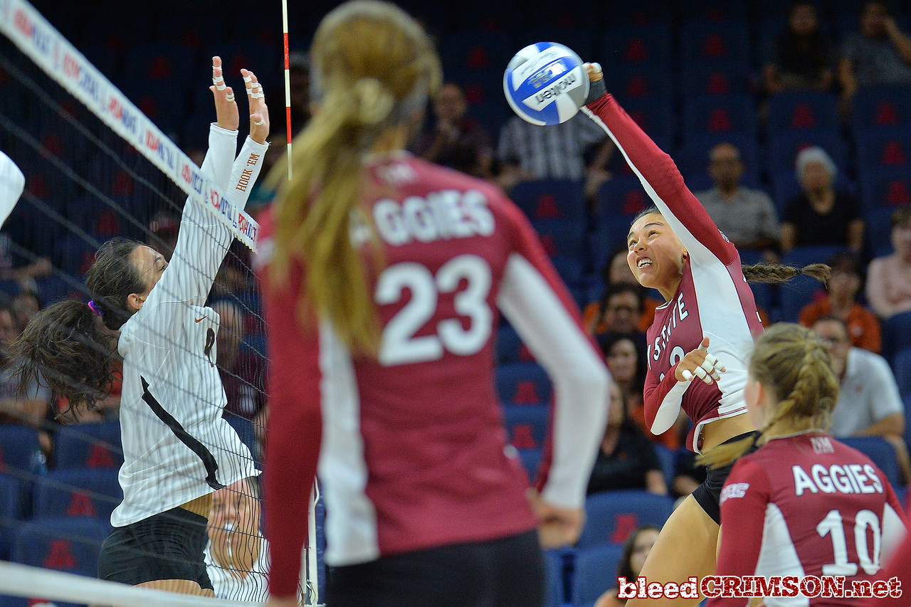 September 19, 2015: Nathalie Castellanos attacks a ball in a match between New Mexico State and No. 2 Texas at McKale Memorial Center in Tucson, Ariz.