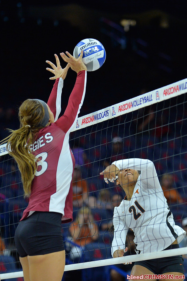 September 19, 2015: Gwen Murphy blocks an attack from Texas setter Chloe Collins (21) in a match between New Mexico State and No. 2 Texas at McKale Memorial Center in Tucson, Ariz.