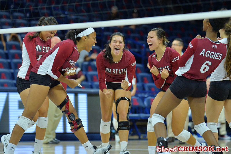 September 19, 2015: The Aggies celebrate a point in a match between New Mexico State and No. 2 Texas at McKale Memorial Center in Tucson, Ariz.