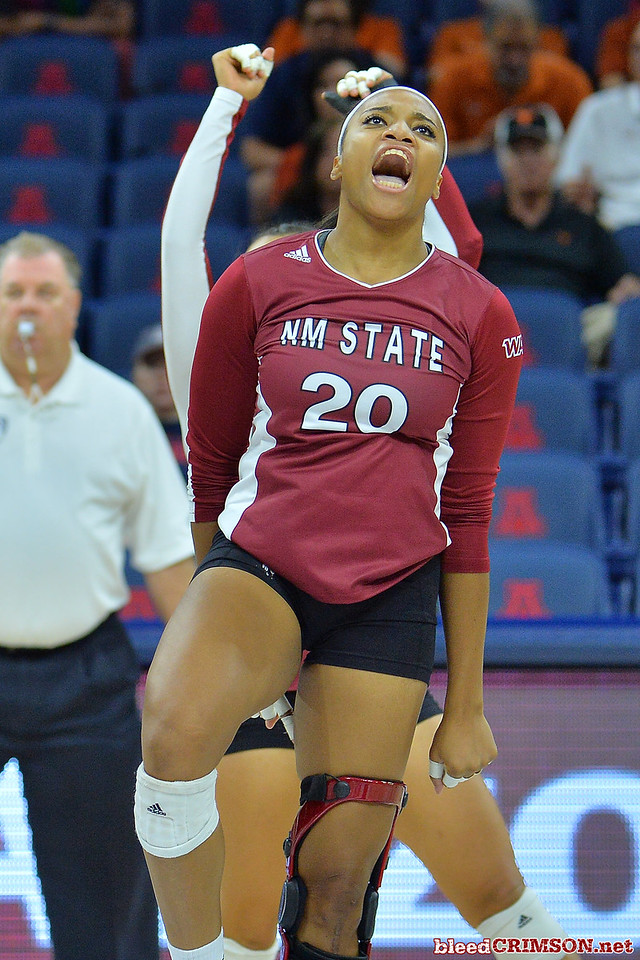September 19, 2015: Sasha-Lee Thomas celebrates a block in a match between New Mexico State and No. 2 Texas at McKale Memorial Center in Tucson, Ariz.